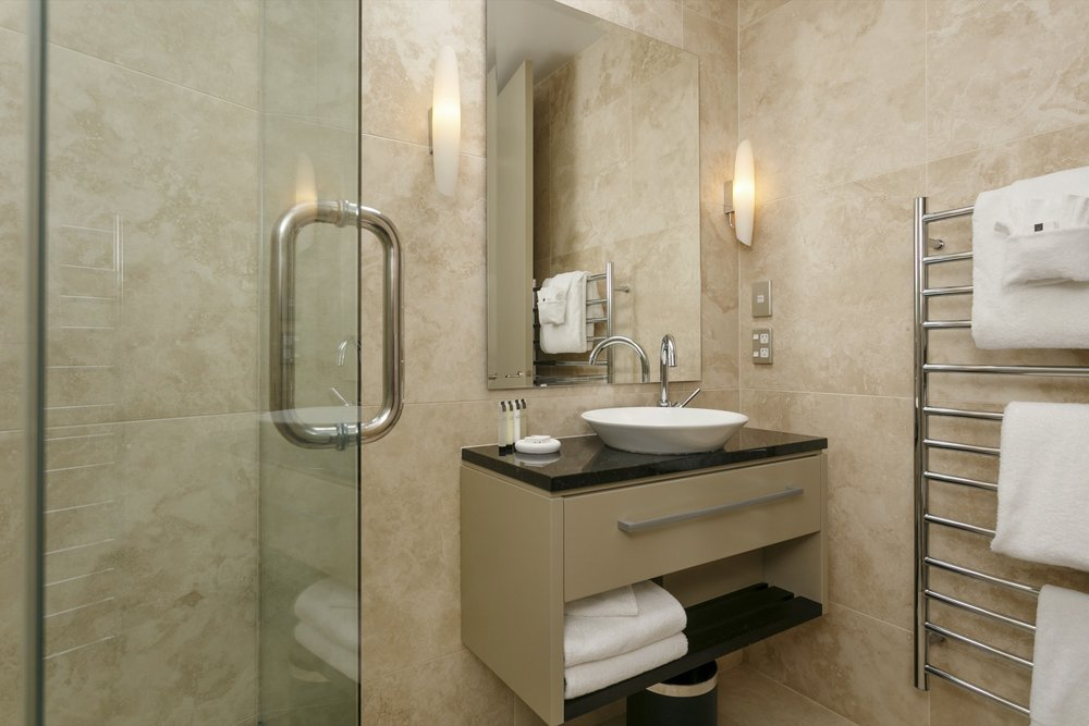 First floor three bedroom apartment second bedroom ensuite bathroom.jpg
