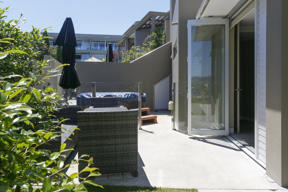 Ground floor two bedroom apartment outdoor furniture and private spa pool.jpg
