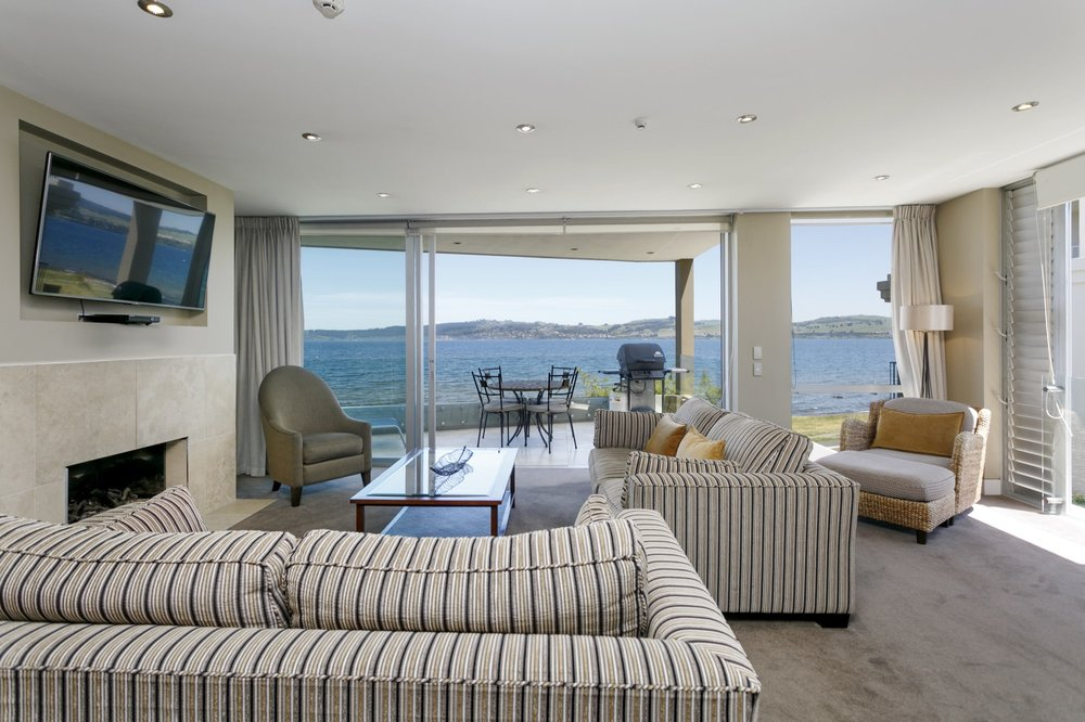 F  irst Floor Three Bedroom Apartment - d ining, kitchen and living areas with spectacular lake views over lake Taupo