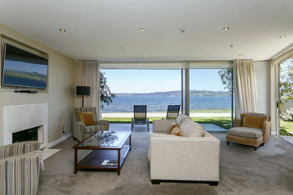 Ground Floor Two Bedroom Apartment - dining, kitchen and living areas with spectacular lake views over lake Taupo