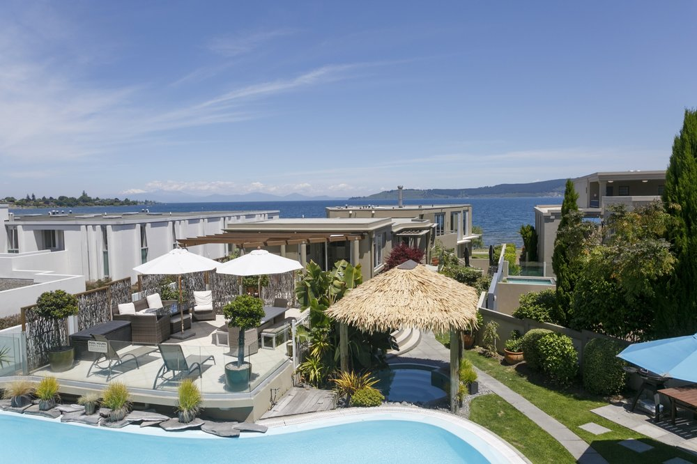 Luxury Studio with Lake Views view from balcony of pool area and lake Taupo and mountains -min.jpg