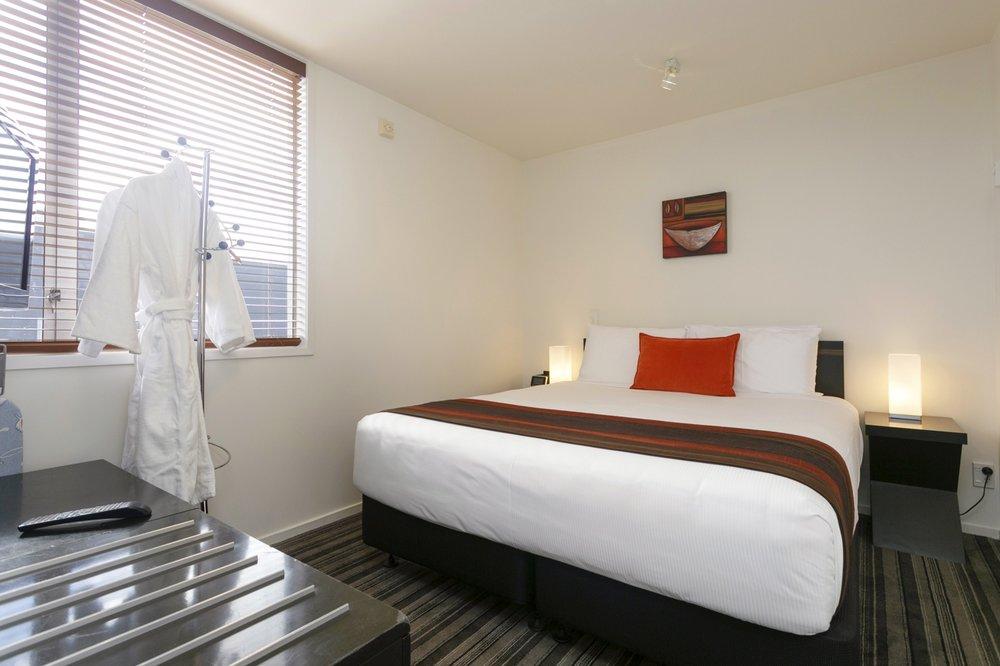 One Bedroom with Lake Views bedroom 1-min.jpg