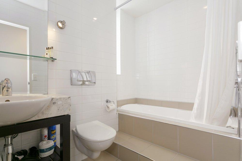 One Bedroom with Lake Views bathroom 1-min.jpg