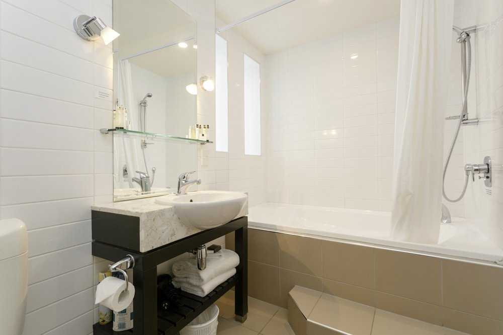 One bedroom poolside bathroom with spa bath 1-min.jpg