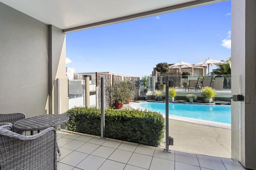 One bedroom poolside patio 1-min.jpg