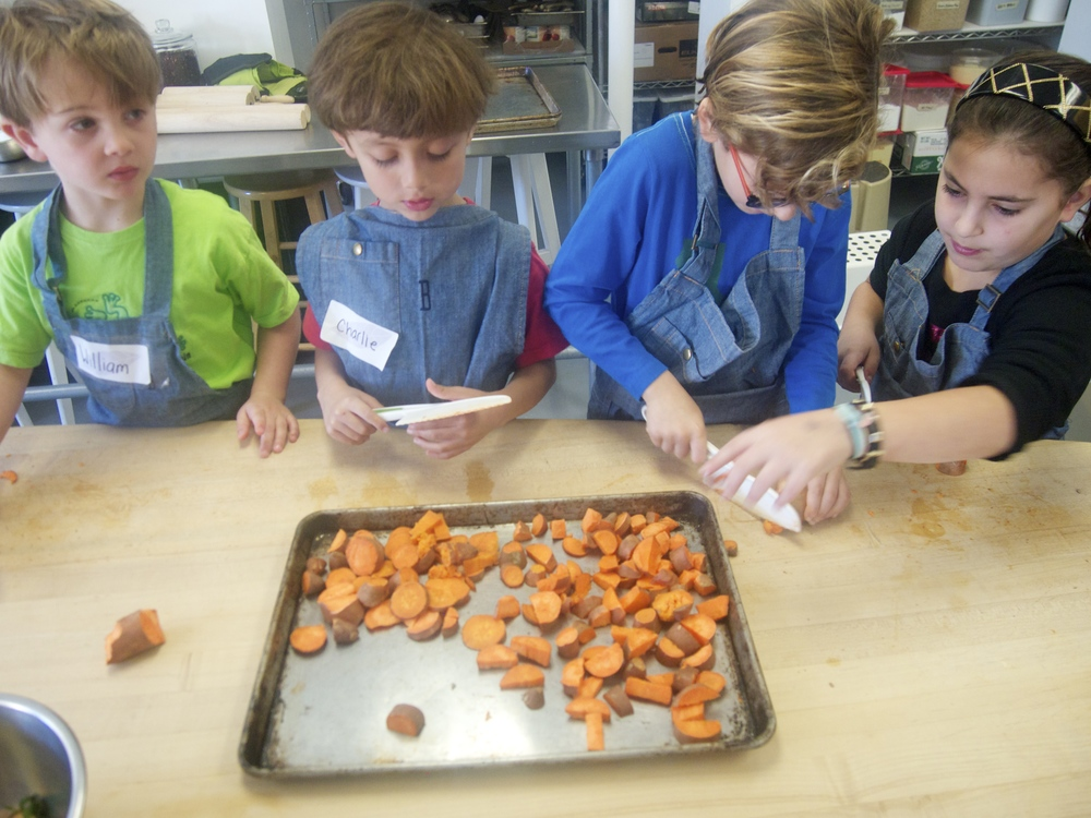 Cutting up sweet potatoes to be roasted for our quesadillas!