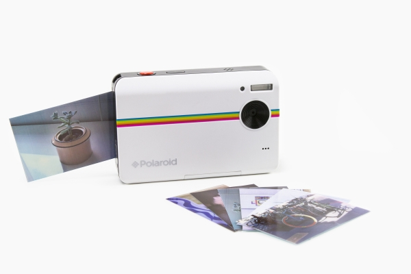 I specifically love this one because it works like a digital camera. It's a little less instant, as you can flip through which images you want to print. Instant film can get fairly pricey - so any way to avoid wasting it is okay in my book.