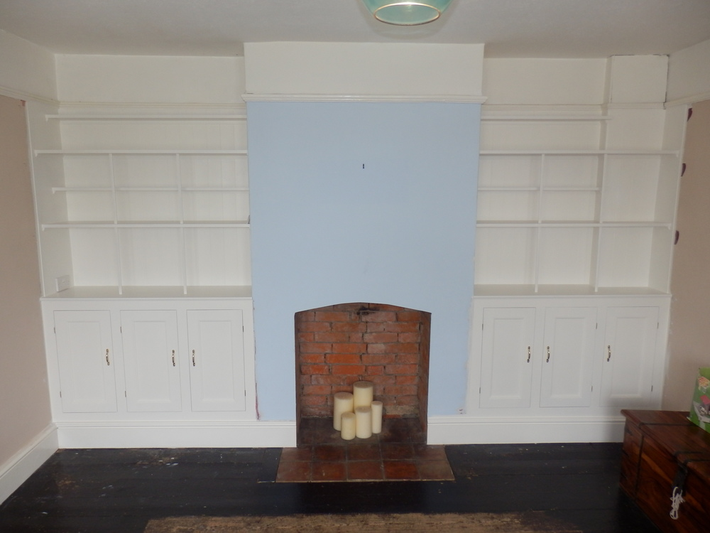 Built in fireside shelving / cupboards