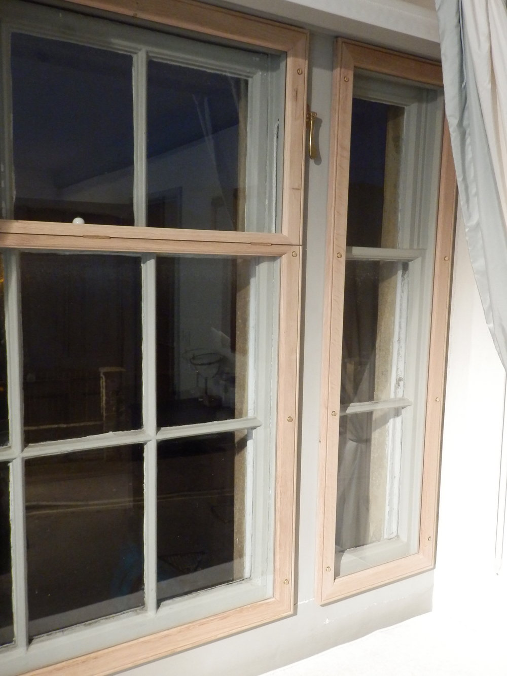 The house in question fronts a road so the bedroom windows were also fitted with opening frames to alleviate road noise. These were made in the same style as the reception room units.