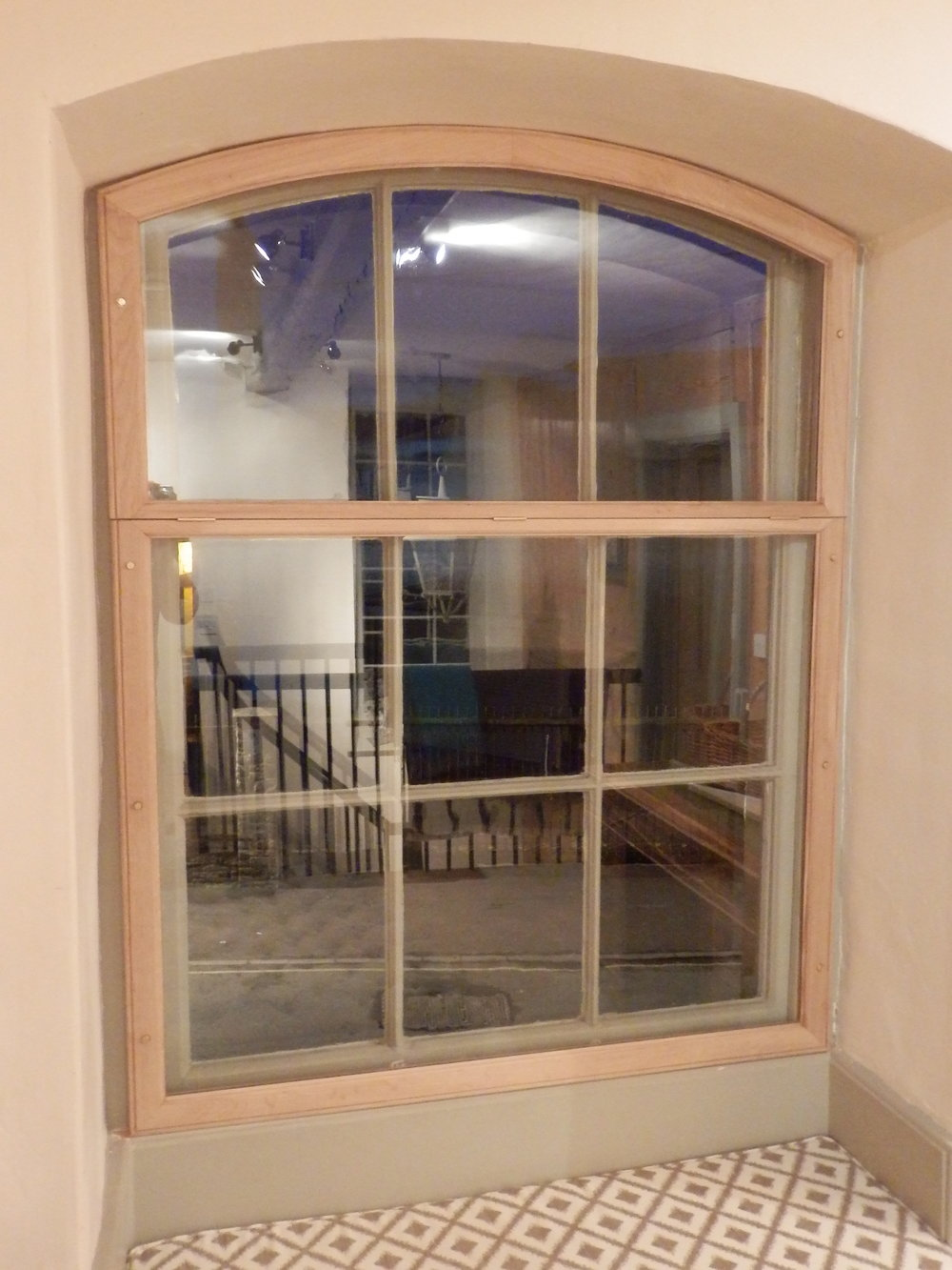 A curved landing window also needed secondary glazing.