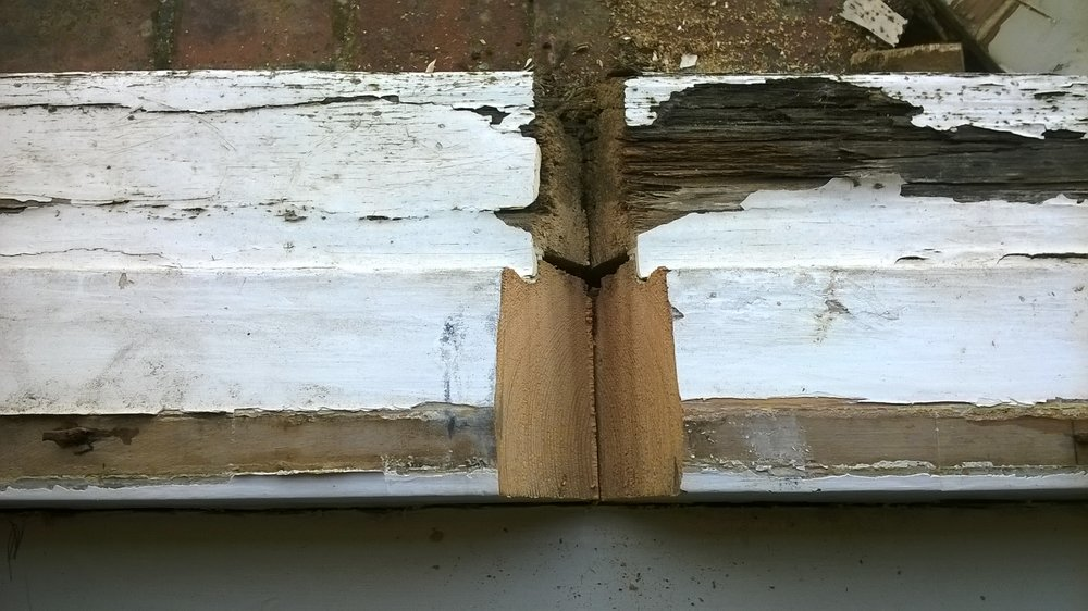 As discovered on this job. A typical 'repair' of cutting away rotten front edge of sill and replacing with a softwood length. Poorly carried out, this repair has not lasted any length of time and, as you can see, has deteriorated much faster than the original frame.