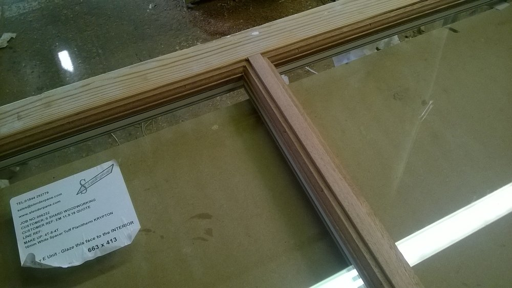 Exteriror hardwood mouldings glued to original frames. Profiled to look like traditional putty.