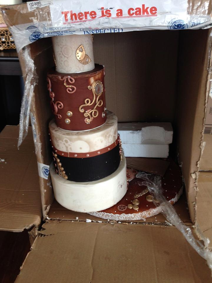 This is how it got back to NY BUT it also arrived in Louisiana in the same shape…  popped off of the base and leaning on the box. Yup! This really happened the day before I had to register this cake for competition.