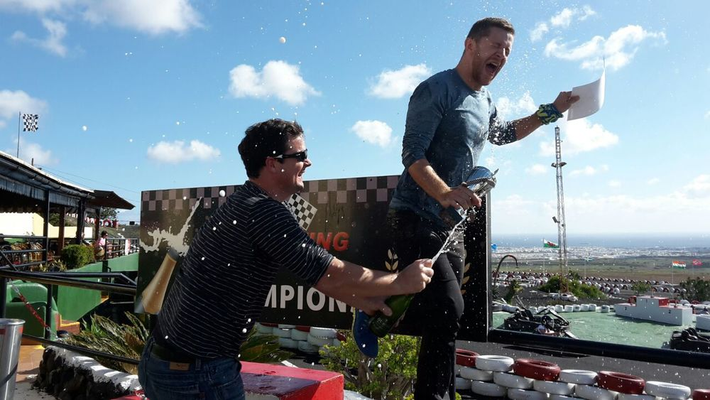 I love this picture haha Lars may have won the go-kart race but Ronny owned him on the podium with the champagne!