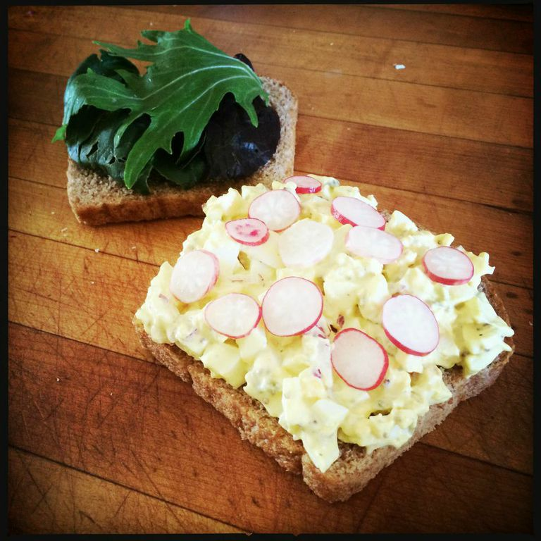 Serve garnished with pickled breakfast radishes and field greens.