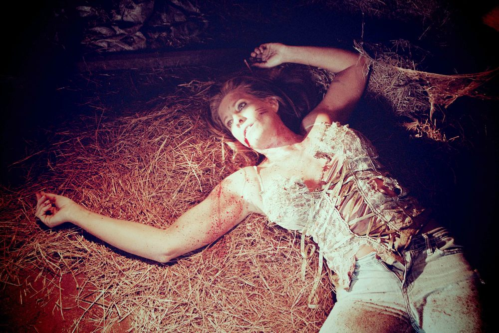 THE REEL OF HORROR - FEMALE VICTIM IN BARN.jpg
