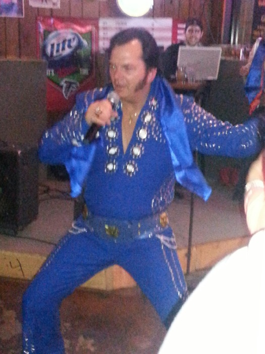 Brad Latham as Elvis