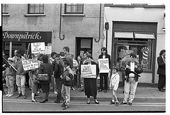 Sinn Fein Protest, Downpatrick, against shooting death of PIRA man Colm Marks by the RUC, 1990s. Bobbie Hanvey, photographer. Image bh011750, Bobbie Hanvey Photographic Archives, John J. Burns Library, Boston College. This image is part of a series of images found at:  hdl.handle.net/2345/1926