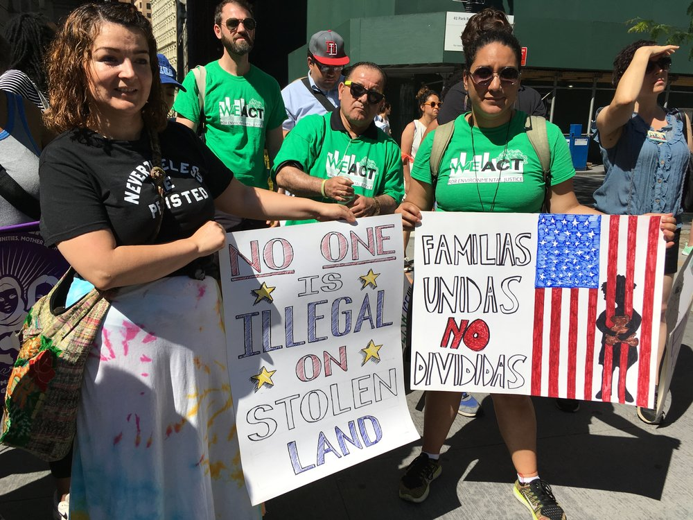 Activists from  WE ACT For Environmental Justice  display their signs at Families Belong Together March & Rally on June 29th, 2018 in New York City.