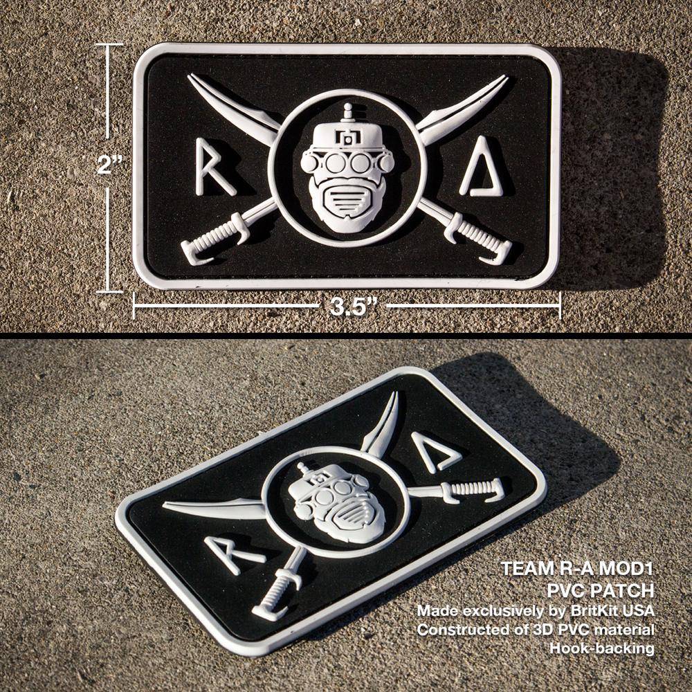 "Team R-A MOD1 PVC Patch  Made exclusively by BritKit USA. Constructed of PVC material with hook backing. White/Black. 3.5"" x 2.0""   $10 USD     STOCK: IN STOCK!"