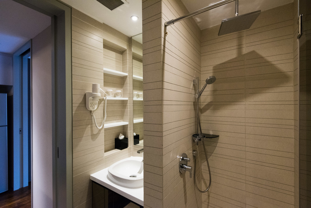 Rain Shower in the Bathroom of the One Bedroom Deluxe Suite