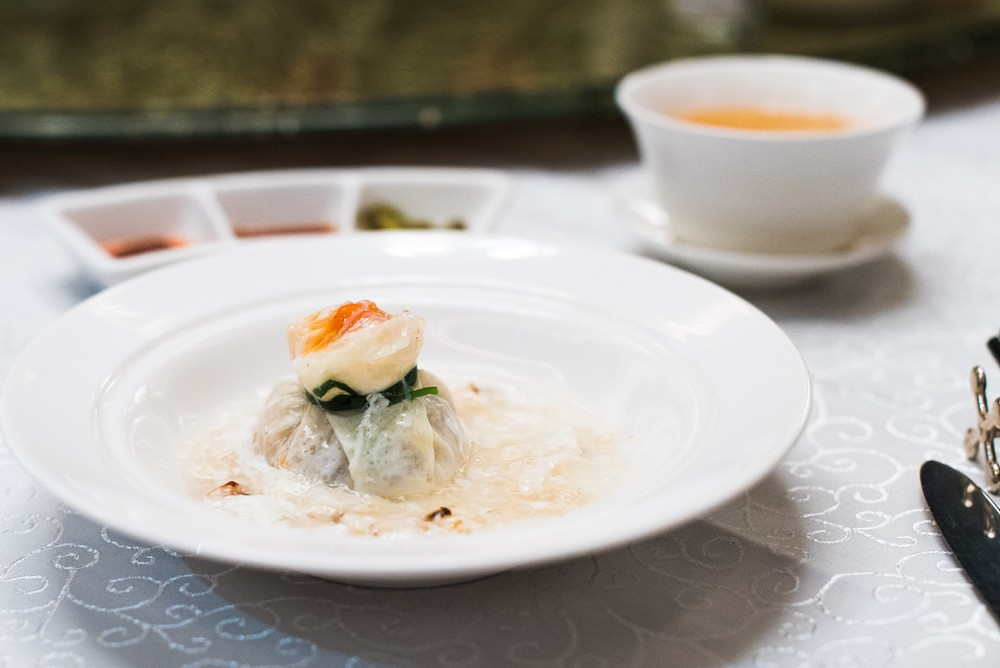Steamed Seafood Dumpling with Egg White Sauce (蟹肉扒石榴球)
