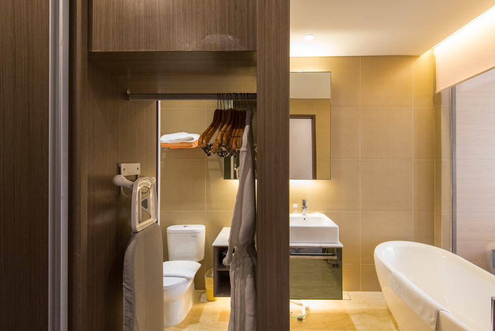Wardrobe that opens into the Bathroom at Dorsett Singapore