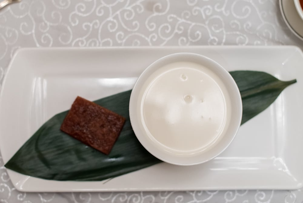 Fragrant Homemade Almond Tea served with Crispy Glutinous Rice Cake    Yan Ting - The St. Regis Singapore