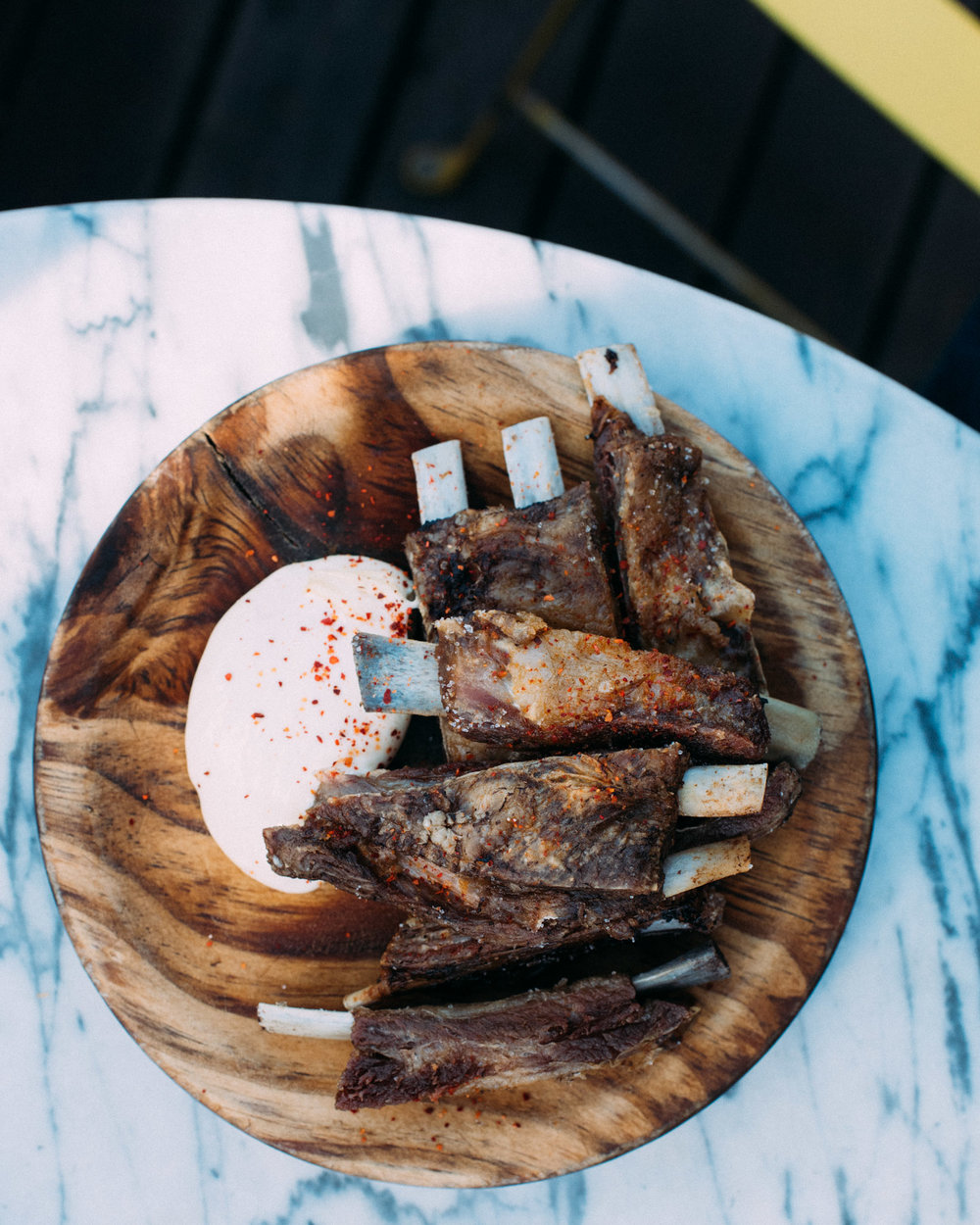 Fried Lamb Ribs, Piment d'espelette, Aioli Naked in the Sky - Melbourne, Australia
