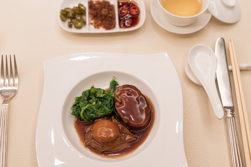 Braised Sea Cucumber stuffed with Minced Shrimp and Pork, served with Abalone  Golden Peony - Conrad Centennial Singapore