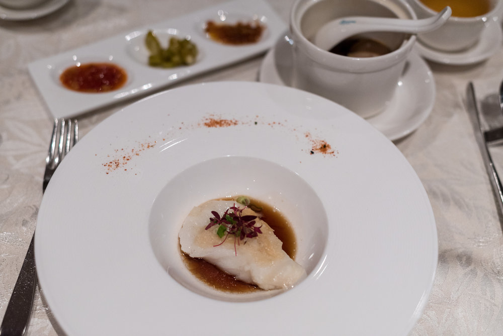 Steamed Fillet of Sea Perch with Dried Scallops and Minced Garlic Crumble  Hai Tien Lo - Pan Pacific Singapore