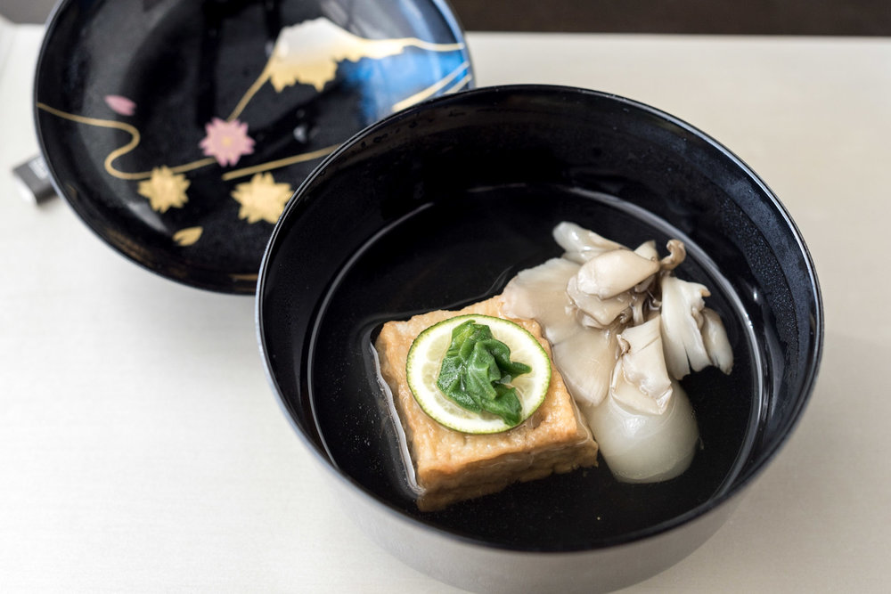 Clear Soup with Fried Pike Conger Dumpling, Turnip, Turuna Leaves, Maitake and Japanese Citrus  Kazahana - Conrad Tokyo