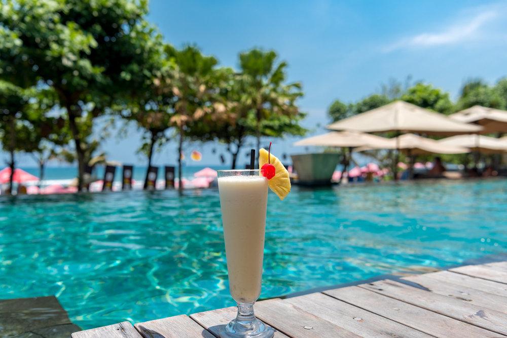 Piña colada by the Pool Infinity Pool - Anantara Seminyak Bali Resort
