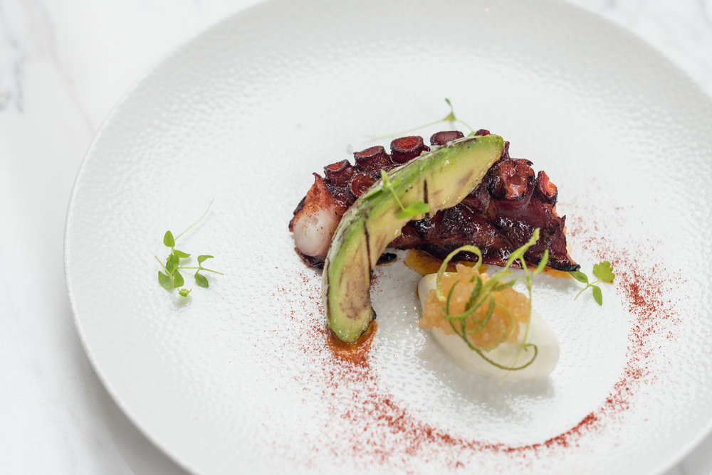Chargrilled Galician Octopus with Avocado, Lime   Crème Fraîche and Smoked Sweet Paprika  Racines - Sofitel Singapore City Centre