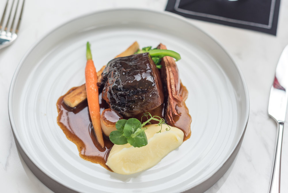 48-hour Slow-cooked Wagyu Beef Cheek, Truffled Mashed Potatoes and Seasonal Greens  Racines - Sofitel Singapore City Centre