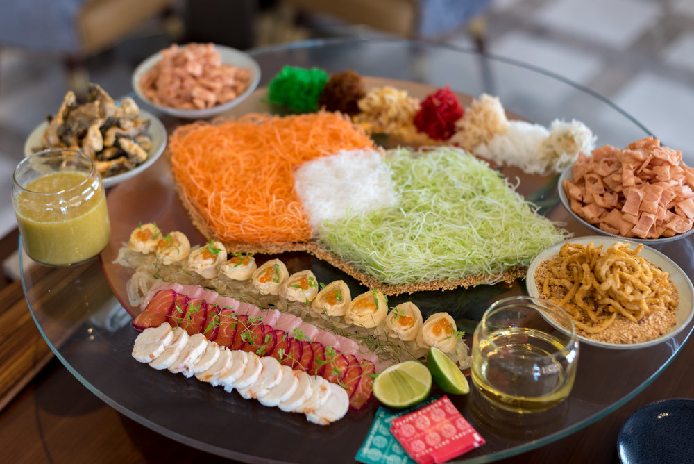 Chef's 8 Treasures 'Yu Sheng' with Yuzu Dressing and Condiments]  Racines - Sofitel Singapore City Centre