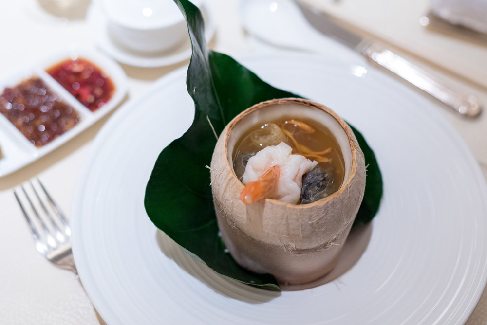 Double-boiled Cordycep Flower Soup with New-Caledonia Obsiblue Prawn and Black Chicken in Whole Young Coconut  Golden Peony - Conrad Centennial Singapore
