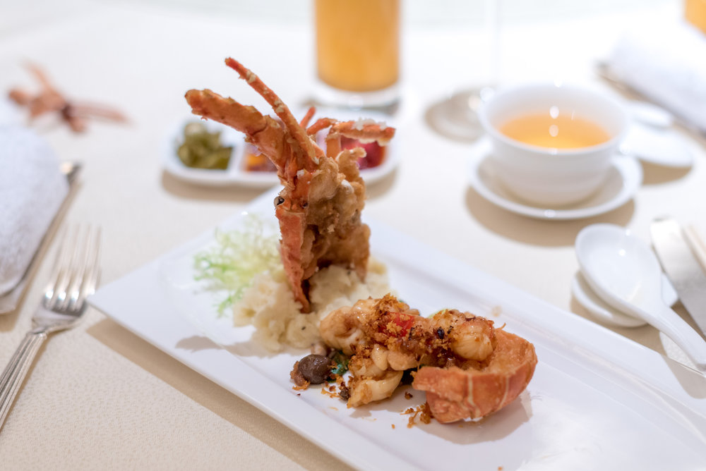 Stir-fried Half Lobster topped with Crispy X.O. Chilli Sauce  Golden Peony - Conrad Centennial Singapore