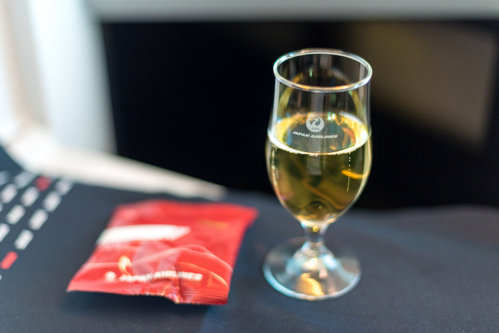 Champagne and Rice Crackers  Japan Airlines Business Class JL31 777-200ER - HND to BKK