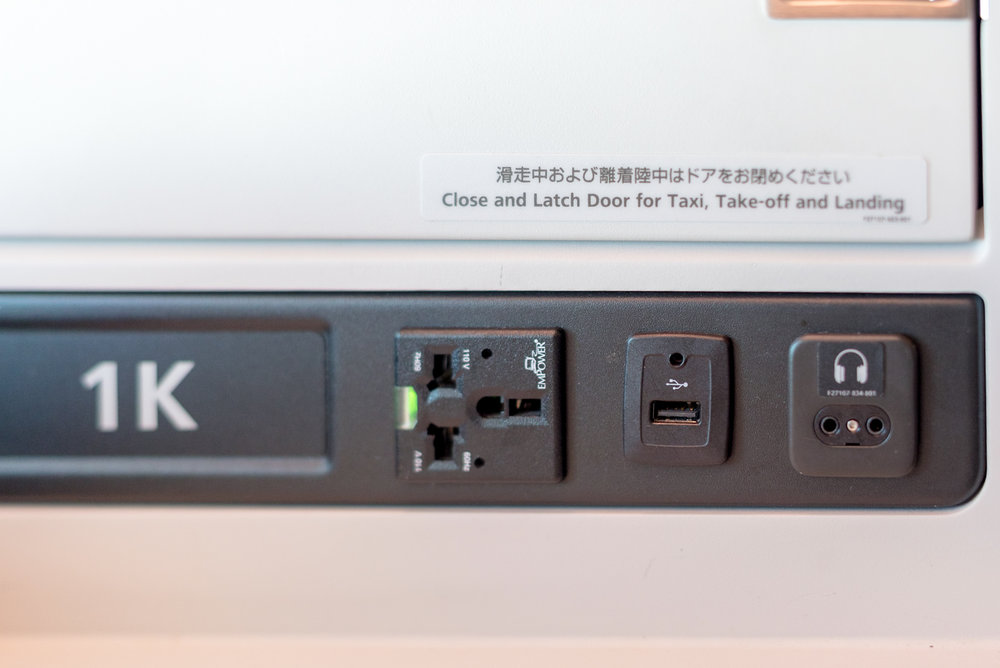 Universal Power Outlet and USB Charging Port  Japan Airlines Business Class JL31 777-200ER - HND to BKK