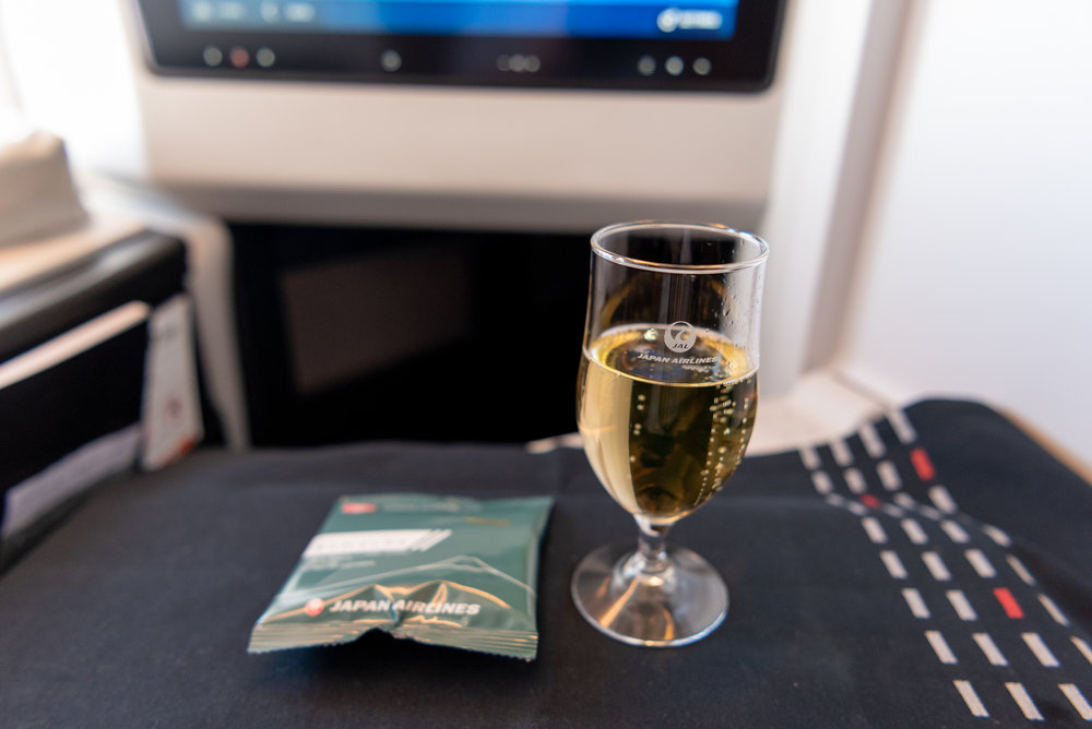 Champagne and Rice Crackers  Japan Airlines Business Class JL37 - HND to SIN