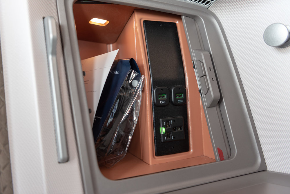Stowage Compartment and Charging Ports  Singapore Airlines Business Class SQ942 787-10 - SIN to DPS