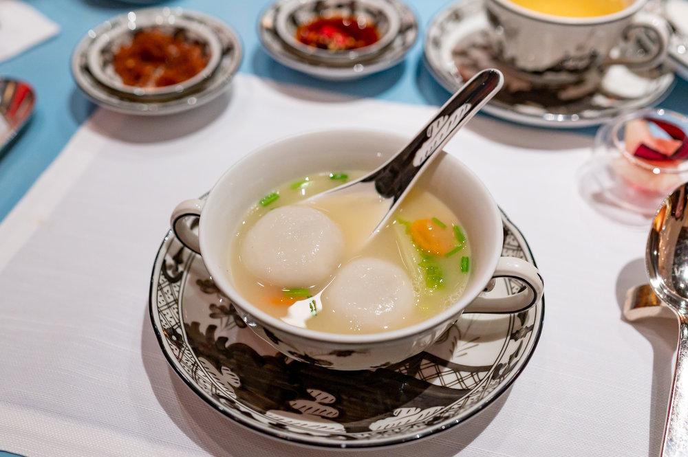 Poached Iberico Pork Rice Dumpling, Cabbage in Superior Stock  Summer Pavilion - The Ritz-Carlton, Millenia Singapore