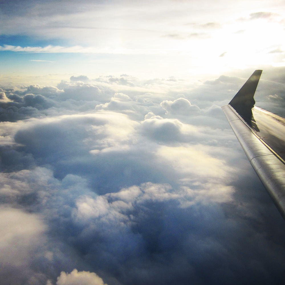 Plane Window, Clouds, Wing, Frequent Flyer - A Pilot's Daughter