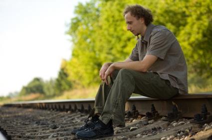 Rumination - man sitting on track iStock_000002346047XSmall.jpg
