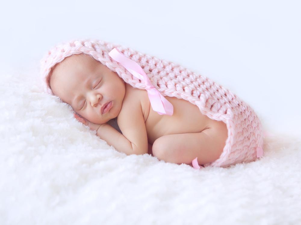 Newborn sleeping in pink