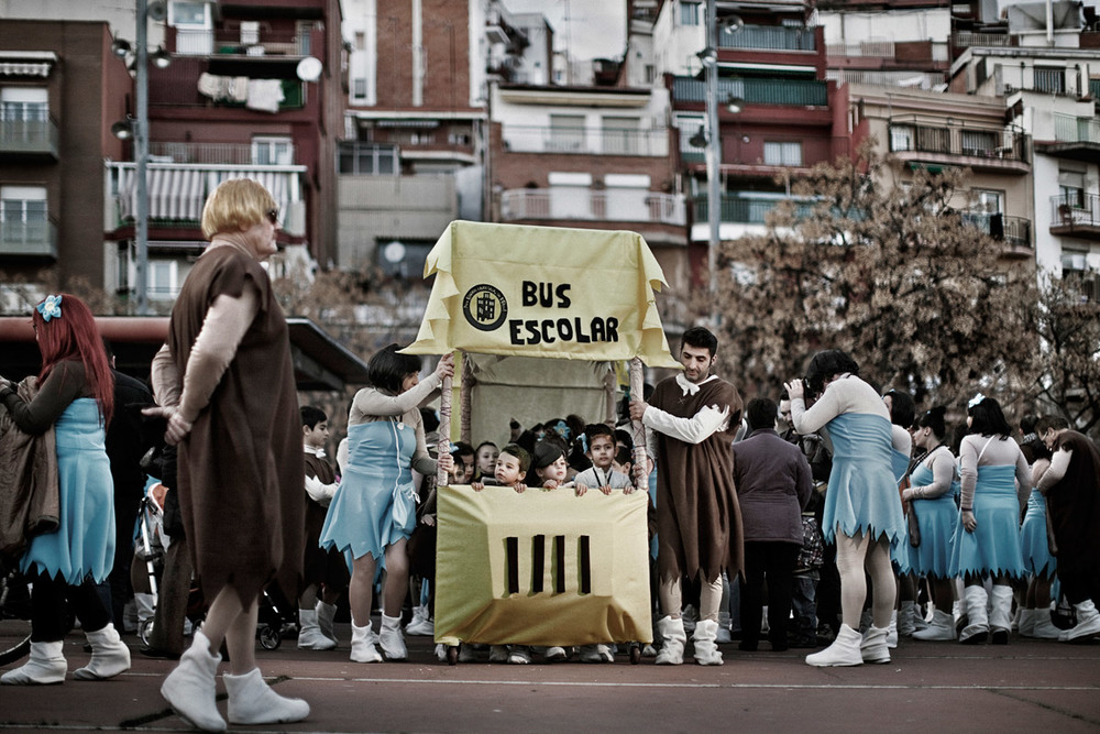 Carnival celebrations organised by the neighbours of Roquetes. All the participants are dressed as Flintstone characters, 'because budget cuts send us back to the stone age'. Barcelona