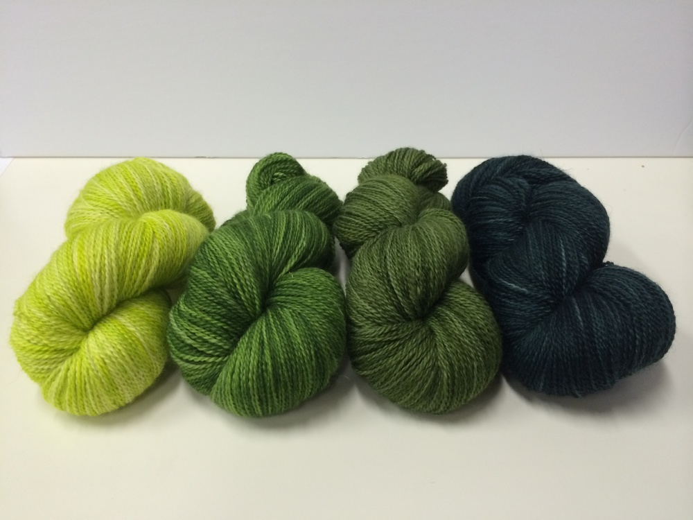 Our four green colourways shown on Hennessy Fingering,