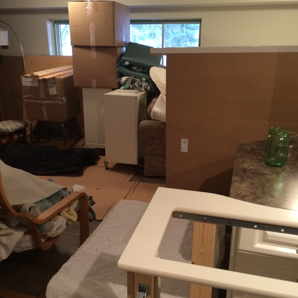 This is about what our house looks like right now ... those big boxes from the mill sure did come in handy for the move!