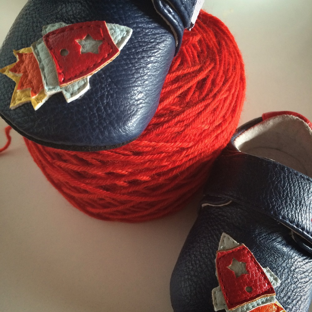 "I picked up these rocket booties for our boy and a coordinating blanket this fiery red-orange is perfect. I couldn't help but call the project, ""love you to the moon and back""."